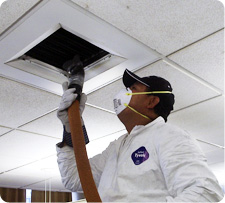 A TERS worker cleans and sanitizes a duct to prevent recurring contamination